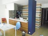 キッチンリフォームアクセント壁紙で、より明るい空間に仕上げたキッチン